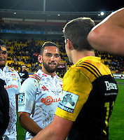 Aaron Cruden shakes hands with Beauden Barrett after the Super Rugby semifinal match between the Hurricanes and Chiefs at Westpac Stadium, Wellington, New Zealand on Saturday, 30 July 2016. Photo: Dave Lintott / lintottphoto.co.nz