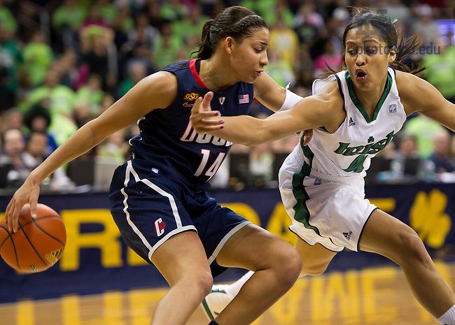 January 7, 2012; Notre Dame Fighting Irish Skylar Diggins pressures Connecticut Huskies guard Bria Hartley during the second half at the Purcell Pavilion. Notre Dame won 75 to 67 in overtime. Photo by Barbara Johnston/University of Notre Dame