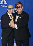 a_Bernie Taupin, Elton John  poses in the press room with awards at the 77th Annual Golden Globe Awards at The Beverly Hilton Hotel on January 05, 2020 in Beverly Hills, California.