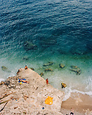 CROATIA, Dubrovnik, Dalmatian Coast, elevated view of group of people sunbathing by seashore