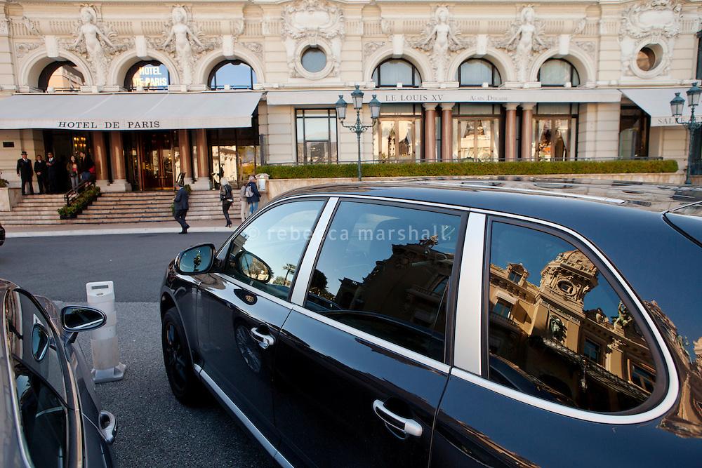 L'Hotel de Paris, Casino Square, Monte Carlo, Monaco, 21 March 2013. The Casino de Monte Carlo can be seen reflected in the car's windows.
