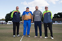 Ollie Peck of Upminster. Nick Browne of Essex with umpires Pip George and Ray Clark during Upminster CC vs Essex CCC, Benefit Match Cricket at Upminster Park on 8th September 2019