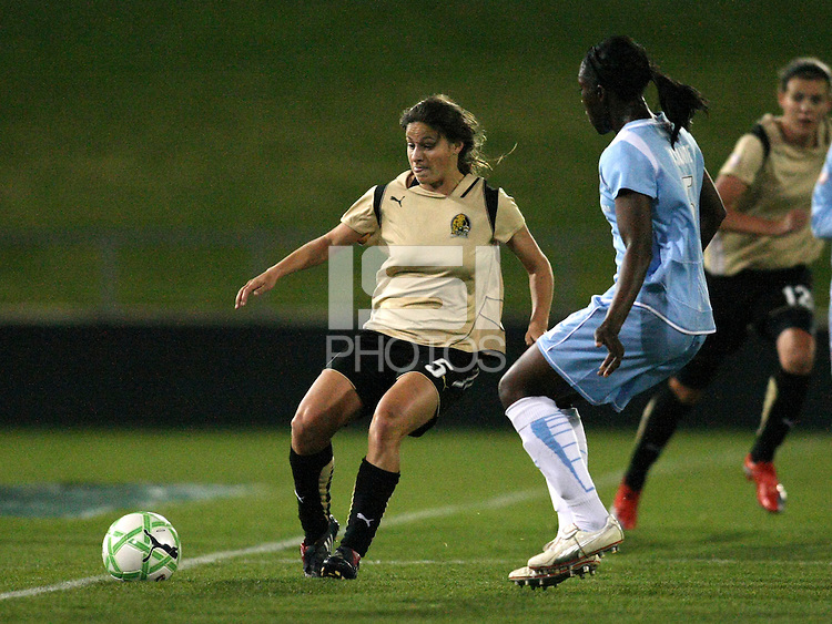 FC Gold Pride midfielder Tina DiMartino attempts to pass Sky Blue defender Anita Asante (5).  Sky Blue FC and FC Gold Pride battled to a 1-1 draw in Bridgewater, NJ on Saturday, April 11, 2009.