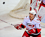 21 December 2008: Carolina Hurricanes' right wing forward Justin Williams keeps his eye on a high-flying puck in the third period against the Montreal Canadiens at the Bell Centre in Montreal, Quebec, Canada. The Hurricanes defeated the Canadiens 3-2 in overtime. ***** Editorial Sales Only ***** Mandatory Photo Credit: Ed Wolfstein Photo
