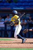Michigan Wolverines second baseman Ako Thomas (4) at bat during a game against Army West Point on February 17, 2018 at Tradition Field in St. Lucie, Florida.  Army defeated Michigan 4-3.  (Mike Janes/Four Seam Images)