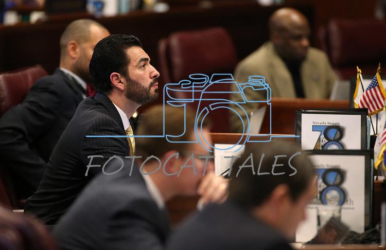 Nevada Sen. Ruben Kihuen, D-Las Vegas, works on the Senate floor at the Legislative Building, in Carson City, Nev., on Friday, Feb. 20, 2015. <br /> Photo by Cathleen Allison