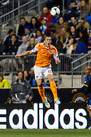 Cam Weaver (15) of the Houston Dynamo heads the ball. The Houston Dynamo defeated the Philadelphia Union 1-0 during a Major League Soccer (MLS) match at PPL Park in Chester, PA, on September 14, 2013.