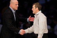 STATE COLLEGE, PA - FEBRUARY 8: Head coach Tom Brands of the Iowa Hawkeyes and head coach Cael Sanderson of the Penn State Nittany Lions shake hands after the match on February 8, 2015 at the Bryce Jordan Center on the campus of Penn State University in State College, Pennsylvania. The Hawkeyes won 18-12. (Photo by Hunter Martin/Getty Images) *** Local Caption *** Tom Brands;Cael Sanderson