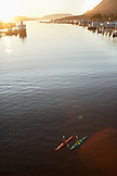 USA, Alaska, Sitka, kayakers paddle in Sitka Harbor at  the end of the day
