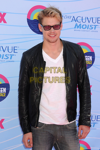 Chord Overstreet.Teen Choice Awards 2012 - Arrivals held at Gibson Amphitheatre, Universal City, California, USA..July 22nd, 2012.half length leather jacket white top black leather facial hair stubble goatee sunglasses shades .CAP/ADM/BP.©Byron Purvis/AdMedia/Capital Pictures.
