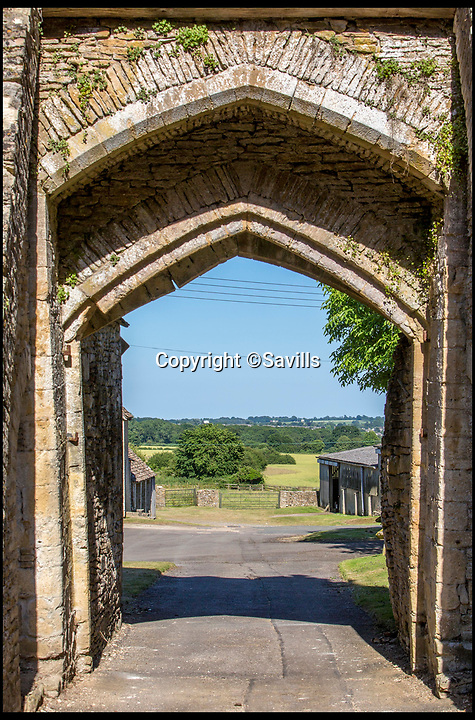 BNPS.co.uk (01202)558833<br /> Pic:   Savills/BNPS<br /> <br /> The gateway to the courtyard, looking out.<br /> <br /> A 800 year old castle that stands over Prince Charles' Highgrove estate and was left a ruin by the Civil War has gone on the market for £10m.<br /> <br /> Beverston Castle, on the outskirts of Tetbury, Gloucs, is only partly habitable today but has a charming seven bedroom manor house built on to it.<br /> <br /> The historic property, that comes with a huge 693 acres of land, had been owned for 70 years by the late showjumper Major Laurence Rook and his wife Jane.<br /> <br /> The couple were famed for the hospitality they laid on to visitors of the week-long Badminton Horse Trials which is nearby.