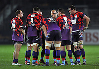 UK Armed Forces players huddle together during a break in play. Remembrance Rugby match, between Bath United and UK Armed Forces on November 9, 2015 at the Recreation Ground in Bath, England. Photo by: Patrick Khachfe / Onside Images