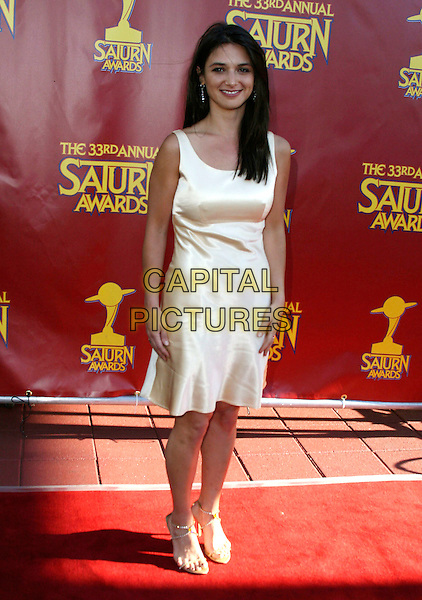 ANDREA GABRIEL.33rd Annual Saturn Awards presented by the Academy Of Science Fiction, Fantasy and Horror Films held at the Universal City Hilton Hotel,Universal City, California, USA, 10 May 2007..full length cream dress.CAP/ADM/CH.©Charles Harris/AdMedia/Capital Pictures.