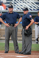 Umpire Jimmy Volpi (L) and Barry Lee (R) during a NY-Penn League game at Dwyer Stadium on July 30, 2006 in Batavia, New York.  (Mike Janes/Four Seam Images)