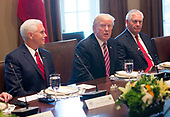 United States President Donald J. Trump speaks to the media during a meeting with Amir Sabah al-Ahmed al-Jaber al-Sabah of Kuwait at The White House in Washington, DC, September 7, 2017.  At left is US Vice President Mike Pence and at right is US Secretary of State Rex Tillerson. <br /> Credit: Chris Kleponis / Pool via CNP