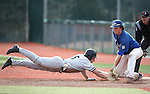 College of Southern Idaho's Blake Sanchez dives safely back under the tag of Western Nevada's Daniel Nist during a game in Carson City, Nev. on Friday, Mar. 4, 2016. <br />
