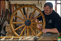 BNPS.co.uk (01202 558833)<br /> Pic: RachelAdams/BNPS<br /> <br /> Greg Rowland works on a wheel for Wellington College's Gun Run at Earl's Palace.  <br /> <br /> The Rowlands are coachbuilders by Appointment to the Queen and charged with maintaining wheels and carriages in the Royal Collection. <br /> <br /> The Heritage Craft Association have released a 'Red list' of Britains most critically endagered crafts and craftsmen.<br /> <br /> The list highlights some age old skills that are in grave danger of becoming extinct in the country formely known as the 'Workshop of the World'.<br /> <br /> According to research carried out on behalf of the HCA, four crafts have become extinct in the UK in the past 10 years &ndash; cricket ball making, gold beating, lacrosse stick making and sieve and riddle making.<br /> <br /> A further 17 crafts are classified as 'critically endangered' since they have only a handful of practitioners and few have any trainees. <br /> <br /> These include saw making, hat block making, horse collar making, paper marbling, piano making and making wooden planes for furniture. <br /> <br /> However, there are artisans scattered around the country keeping these traditional crafts alive who have long waiting lists because there is still a demand for their very specialised skills.