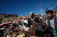 men do business selling dates in the main market of the village of Shibam, Yemen on Friday November the 23rd 2007.///..the reputed home of he Queen of Sheba, Yemen has been at the crossroads of Africa, the Middle East and Asia for thousands  of years thanks to its position on the ancient spice routes. Since unification in 1990, Yemen has been modernizing and opening up to the world, but it still maintains much of its tribal character and old ways. Tensions persist between the north and the south: some southerners say that the northern part of the state is economically privileged.
