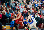WOLCOTT, CT-031418JS10- Wamogo's Sean Coffey (3) drives to the basket past East Hampton's Sean Vick (31) during their Division V semifinal game Wednesday at Wolcott High School. <br /> Jim Shannon Republican-American