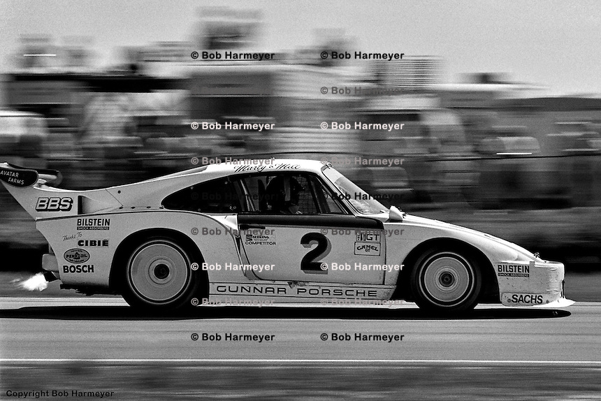 Trailing flame from the turbo, the Porsche 935 of Bill Whittington, Milt Minter and Marty Hinze is under heavy braking at the entry to the hairpin in 1981.