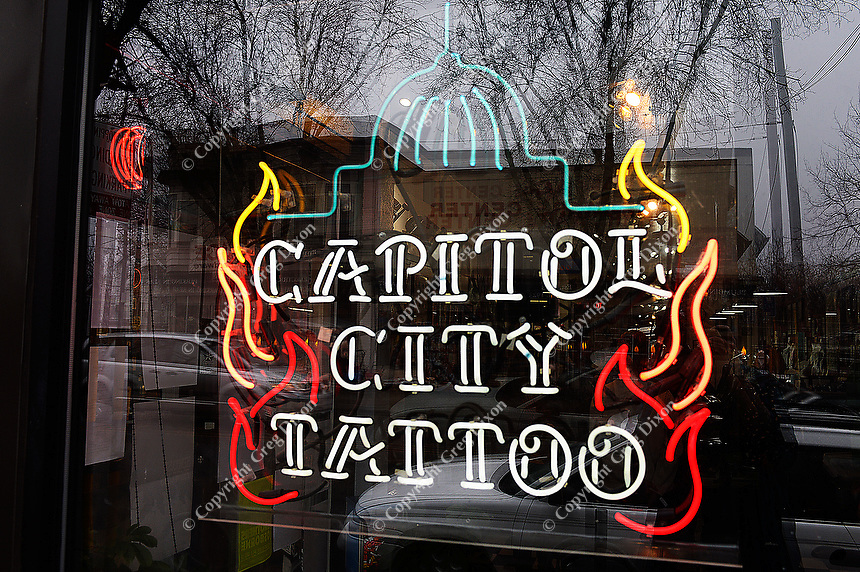 The neon sign lights Capitol City Tattoo in Madison, Wisconsin