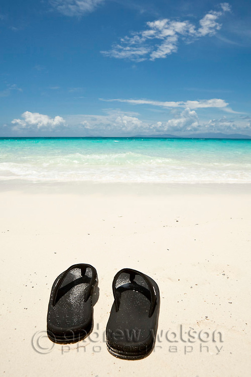 Flip flops on the shore of Vlassof Cay - a remote sand cay near Cairns.  Great Barrier Reef Marine Park, Queensland, Australia