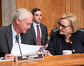 """United States Senator Ron Johnson, Chairman, US Senate Committee on Homeland Security & Governmental Affairs, left, and US Senator Claire McCaskill (Democrat of Missouri), ranking member, right, in discussion before hearing testimony on """"Examining CMS's Efforts to Fight Medicaid Fraud and Overpayments"""" on Capitol Hill in Washington, DC on Tuesday, August 21, 2018.<br /> Credit: Ron Sachs / CNP"""