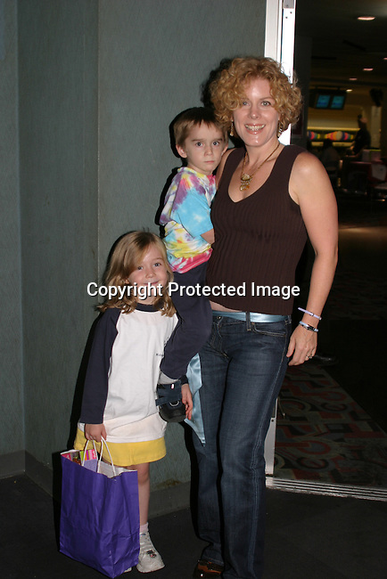 GL = Liz Keifer poses with her kids Keifer and Isabella at the BLoss and Friends Bowling 10-9-04 Port Authority, NYC (. The event benefits the American Heart Assn. This year this event raised over $5000.  Photo by Sue Coflin).
