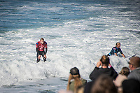 BELLS BEACH, Torquay, Victoria, Australia    (Monday, April 2, 2018) Mick Fanning (AUS) and Sebastien 'Seabass'  Zietz (HAW). - Even though the Rip Curl Pro Bells Beach only ran the first six heats of men&rsquo;s Round 3 today, the second stop on the World Surf League (WSL) Championship Tour (CT) saw rattling upsets. Big names were dispatched from the draw today in four-to-six foot (1.2 - 2 metre) conditions at Bells Beach. Event organizers halted the Round 3 match ups after conditions deteriorated due to an incoming tide and strengthening onshore winds. <br /> <br /> Huge crowds continue to fill into Bells Beach as surf fans hoped to get one more glimpse of their hero Mick Fanning (AUS) as he surfs in his last event as a full time CT competitor. The three-time WSL Champion and four-time Rip Curl Pro Bells Beach event winner did not disappoint, taking down Hawaii&rsquo;s Sebastian Zietz in a blow-for-blow battle. Fanning&rsquo;s trademark arcs in the Bells Bowl saw him win and advance at his swan song event. <br /> <br /> Photo: joliphotos.com