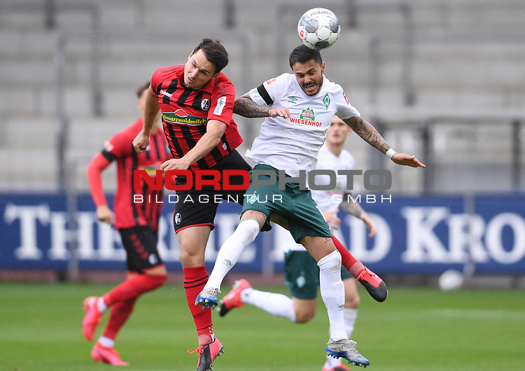 FussballFussball: agnph001:  1. Bundesliga Saison 2019/2020 27. Spieltag 23.05.2020<br /> SC Freiburg - SV Werder Bremen<br /> Nicolas Hoefler (Freiburg links) gegen Leonardo Bittencourt (Bremen rechts)<br /> FOTO: Markus Ulmer/Pressefoto Ulmer/ /Pool/gumzmedia/nordphoto<br /> <br /> Nur für journalistische Zwecke! Only for editorial use! <br /> No commercial usage!