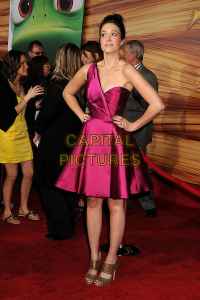 "MANDY MOORE.""Tangled"" Los Angeles Premiere held at the El Capitan Theatre, Hollywood, California, USA..November 14th, 2010.full length pink silk satin one shoulder dress gold peep toe straps sandals shoes hair up  hands on hips.CAP/ADM/BP.©Byron Purvis/AdMedia/Capital Pictures."