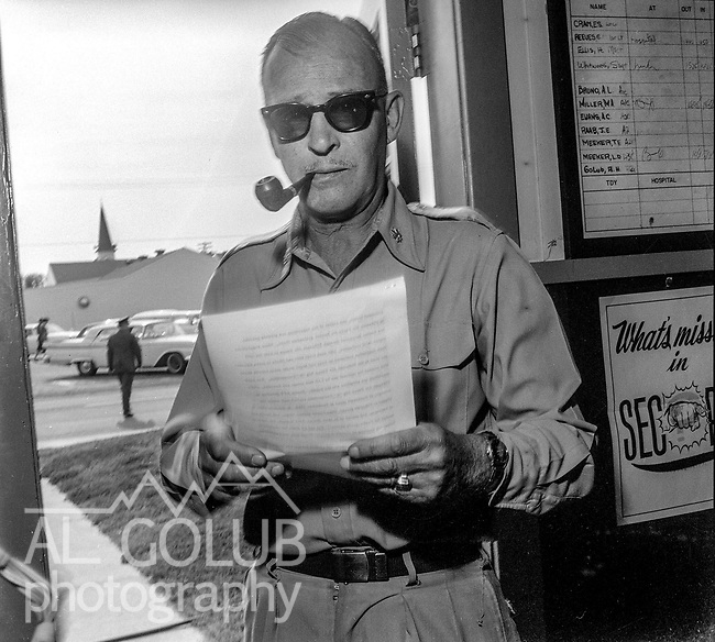 L/C Cram, Director of Information reading a story for the Valley Bomber.<br /> <br /> March 1964: CAFB, California<br /> Staff of the Valley Bomber, 93rd Bomb Wing, Directory of Information, SAC<br /> Photo by Al Golub/Golub Photography <br /> <br /> Castle is named for Brigadier General Frederick W. Castle, who died on Dec. 24, 1944 flying his 30th bombing mission. He died leading an armada of 2000 B-17s on a strike against German airfields. On the way to the target, an engine failure over Liege, Belgium caused his bomber to fall behind, where it was attacked by Germans and caught fire. He ordered his men to bail out but stayed alone at the controls of the flaming Flying Fortress until it crashed. The entire crew, except Gen. Castle and one airman killed before the bailout order, survived. Gen. Castle received a Medal of Honor posthumously for his bravery.<br /> <br /> Castle became home to the 93rd Bombardment Wing in 1947. Aircraft stationed at Castle included B-29, B-17 and C-54 aircraft, with B-50 bombers arriving in 1949. In 1954, B-47 bombers arrived.  On June 29, 1955, Castle received the Air Force's first B-52. These heavy bombers can hold the equivalent of three railroad cars' worth of fuel. The first Air Force KC-135 jet tanker arrived May 18, 1957<br /> <br /> Castle was selected for closure under the Defense Base Closure and Realignment Act of 1990 during Round II Base Closure Commission deliberations (BRAC 91). The last of the B-52s left the base in 1994, followed by the departure of the last of the KC-135s in early 1995. The base closed September 30, 1995.