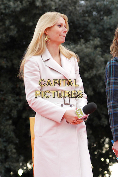 GWYNETH PALTROW.Opening MtV Music Pollination Week on MTV's TRL programme at Pincio in Rome, Italy..November 10th, 2004.half length, white coat, jacket, mac, microphone.www.capitalpictures.com.sales@capitalpictures.com.© Capital Pictures.