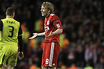 24.02.2011 Europa League Football from Anfield Liverpool v Sparta Prague. Liverpool forward Dirk Kuyt questions a refereeing decision during the second half.