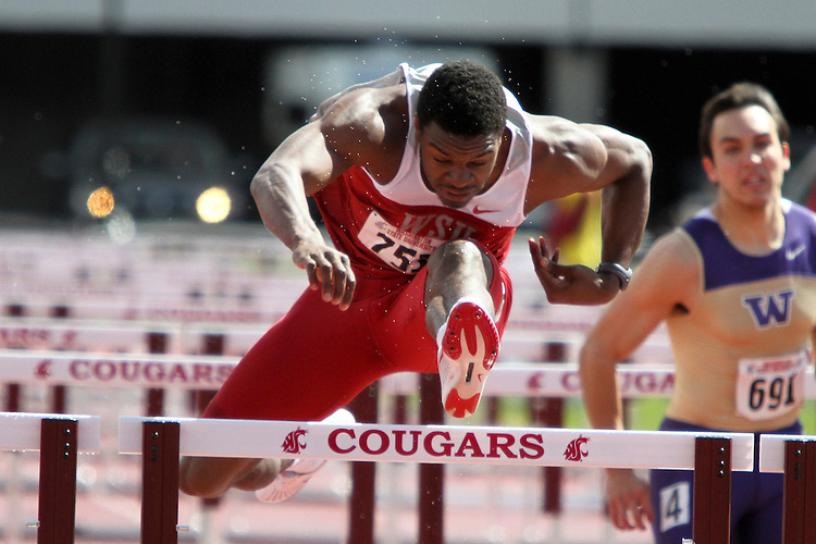Jeshua Anderson, Washington State junior, clears the final hurdle in the 110 meter hurdles final while demolishing the field in the rainy and inclement weather during the Cougars dual track and field meet with arch-rival Washington at Mooberry Track at Washington State University in Pullman, Washington, on May 1, 2010.