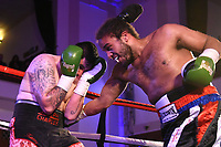 Taran Willet (black/red/blue shorts) defeats Rhys Kaney during a Boxing Show at the Camden Centre on 10th March 2018