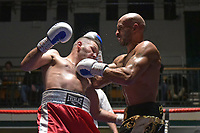 Louis Adolphe (black shorts) defeats Zoltan Szabo during a Boxing Show at York Hall on 30th November 2018