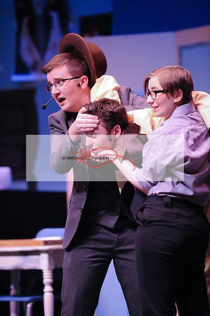 Liam Dooley as Albert Peterson and Maya Bolak of CHS hold up an injured Eric Rueb as Conrad Birdie.