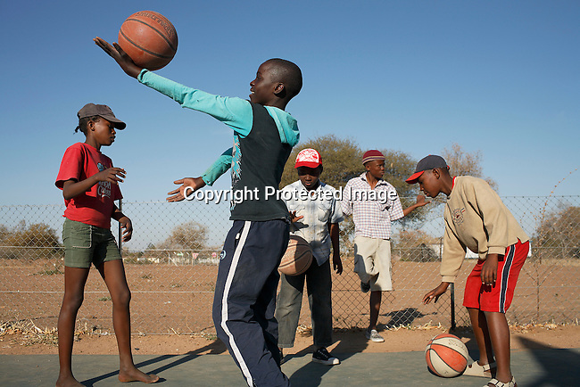 Youth train basketball on a court in Gaborone, Botswana. They are benefiting from ACHAP, African Comprehensive HIV/Aids Partnerships, collaboration between the Government of Botswana, the Bill & Melinda Gates foundation and Merck to prevent and treat HIV/Aids in Botswana. NBA players came to Botswana to give a fitness and basketball clinic at the newly opened court. .Photo by: Per-Anders Pettersson/Getty Images For TIME Magazine