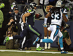 Seattle Seahawks wide receiver Jermaine Kearse (15) out runs the Carolina Panthers safety Tre Boston (33) to score on a 63-yard touchdown pass in  the NFC Western Division Playoffs  at CenturyLink Field in Seattle, Washington on January 10, 2015.The Seahawks beat the Panthers 31-17. ©2015. Jim Bryant Photo. All Rights Reserved.