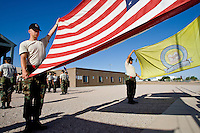 mr-cadets0530   159009- Project Challenge cadet  Michael Jensen holds one side of the flag while posting the colors outside the school Wednesday morning. The program provides a live-in military based education for high school drop outs.  Michael Jensen, of Gilbert, will be the first Arizona Project Challenge cadet to graduate with a high school diploma from Sequoia Choice Arizona Distance Learning in Mesa. (Pat Shannahan/ The Arizona Republic)