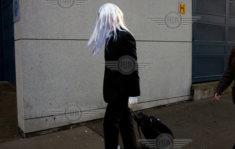 A man in a platinum blonde wig.