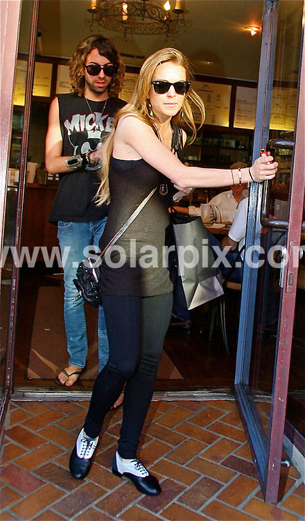 **ALL ROUND PICTURES FROM SOLARPIX.COM**.**WORLDWIDE SYNDICATION RIGHTS EXCEPT FOR USA, AUSTRALIA & GERMANY**.LIndsay Lohan was spotted leaving Judi's Deli after having lunch with Samantha Ronson in Beverly Hills, California, USA...JOB REF:    7412     LAS       DATE:  19.09.08.**MUST CREDIT SOLARPIX.COM OR DOUBLE FEE WILL BE CHARGED* *UNDER NO CIRCUMSTANCES IS THIS IMAGE TO BE REPRODUCED FOR ANY ONLINE EDITION WITHOUT PRIOR PERMISSION*
