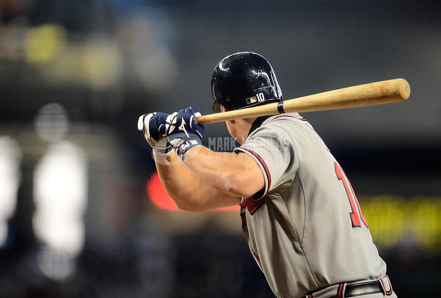 Apr. 22, 2012; Phoenix, AZ, USA; Atlanta Braves third baseman Chipper Jones bats in the sixth inning against the Arizona Diamondbacks at Chase Field.  Mandatory Credit: Mark J. Rebilas-