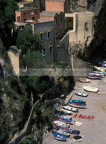 Boats and sun bathing on beach, Furore, Amalfi Coast, Italy