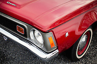 Reinholds, Pennsylvania, February 10, 2015 - A detail of the logo of Brian Moyer's 1971 Base Model AMC Gremlin in matador red. Moyer restored the car over 20 years ago. <br /> <br /> Moyer owns 16 AMC Gremlins. The Gremlin was introduced on April Fools Day (April 1) in 1970 featuring a shortened Hornet body with a Kammback tail and was manufactured in the US via AMC and in Mexico via AMC's subsidiary VAM. It's lifecycle ended in 1978 when it was replaced by the AMC Spirit. Moyer became interested as a kid when he saw the early Gremlin commercials in 1970. His first car was a Gremlin and he has never not owned one. Today he has arguably the most unique collection of Gremlins in the world, including several that are one-of-a kind models. <br /> <br /> CREDIT: Daryl Peveto for The Wall Street Journal<br /> Photo Assignment ID: 36892 <br /> Slug: MYRIDE_Gremlin