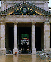 Two figures against a background of gold mosaic flank the clock situated in the pediment above the portico entrance to the spa