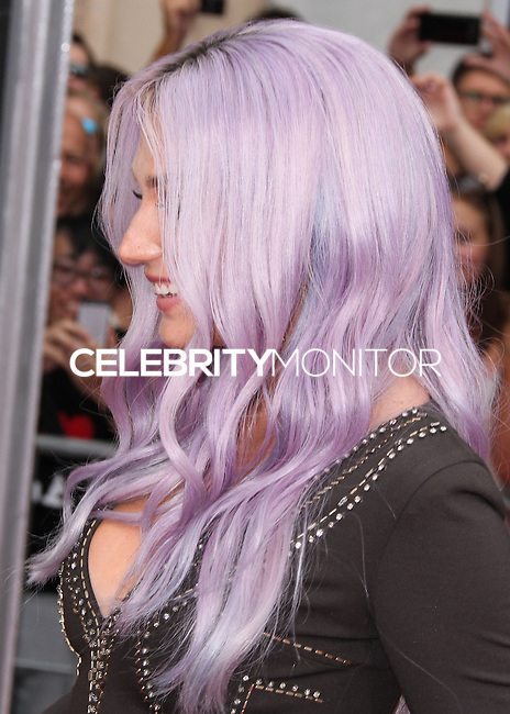 HOLLYWOOD, LOS ANGELES, CA, USA - JULY 15: Singer Kesha arrives at the World Premiere Of Disney's 'Planes: Fire & Rescue' held at the El Capitan Theatre on July 15, 2014 in Hollywood, Los Angeles, California, United States. (Photo by Xavier Collin/Celebrity Monitor)
