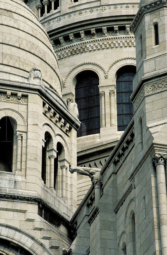 Sacre Coeur Basilica detail of juxtaposed flat and curved surfaces, arches and columns; from southwest. Gargoyle. Paris, France.