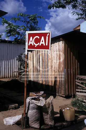 Altamira, Brazil. Acai for sale outside a wooden shack house. Para State.